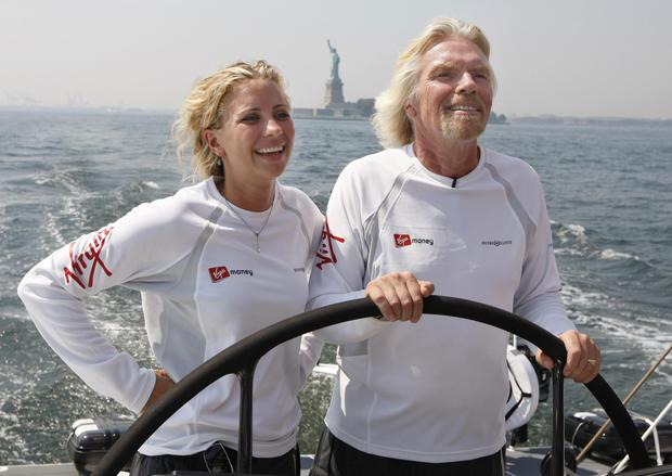 Virgin founder and chairman Richard Branson, pictured with his daughter Holly on the boat 'Virgin Money', during a sea trial in New York harbour. Photo: Reuters