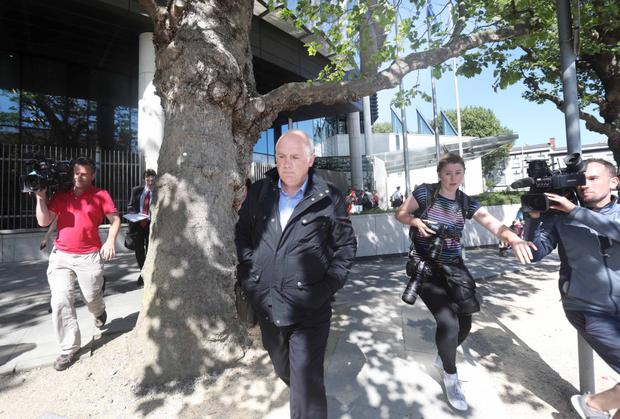 Journalists follow former Anglo CEO David Drumm from court after his fraud conviction. Photo: RollingNews.ie