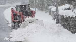 Snow being cleared during Storm Emma
