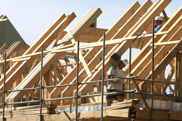 An estimated 80,000 more construction workers are needed to meet housing demand. Photo: Bloomberg
