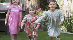 Ava Foy Smyth (5), Hailey Foy (3), and Maggie Elliot (5) show off the popular childrenswear line from Irish designer Cairenn Foy, whose creations are in the running for a top industry award. Photo: Colin O'Riordan