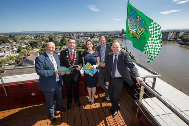Dr Pat Daly, director of economic development and planning for Limerick City and County Council; James Collins, mayor of the City and County of Limerick; Ciara Morley, senior consultant with EY-DKM; Neil Gibson, chief economist, EY Ireland; and Michel Lemagnen, director MCJ Lemagnen Associates, review the report at the Limerick Strand Hotel. Photo: Sean Curtin