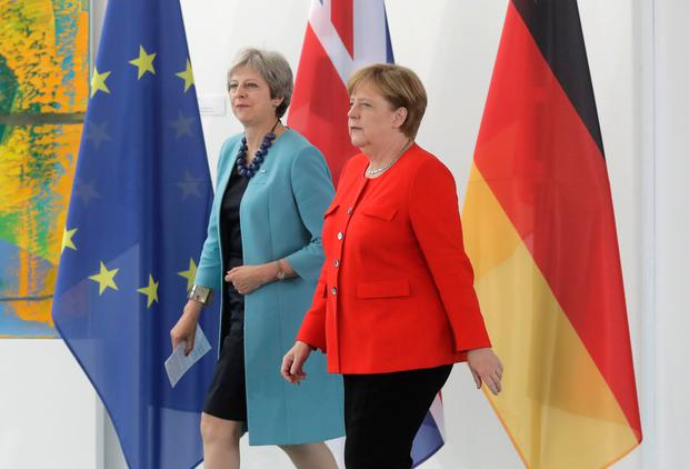British Prime Minister Theresa May and German Chancellor Angela Merkel at a meeting in Berlin Photo: AP