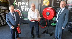 Sean Gallagher with Apex Fire managing director Declan Kelly and finance director Adrian McCabe. Photo Lorraine Tevan