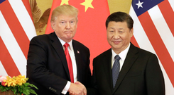 US President Donald Trump and Chinese President Xi Jinping – Chinese state spending has increased in June