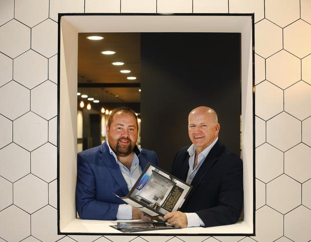 Sean Gallagher with Patrick Doyle, managing director of Halo Tiles and Bathrooms at his showroom in Camolin, Co Wexford. Photo: Damien Eagers