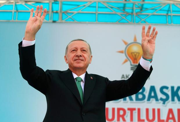 Turkey's President Recep Tayyip Erdogan saluting supporters after Friday prayers, in Bayburt, Turkey, yesterday. Photo: AFP/Getty Images