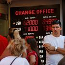 People line up at a currency exchange shop in Istanbul as Turkey's lira plunged. Photo: AP