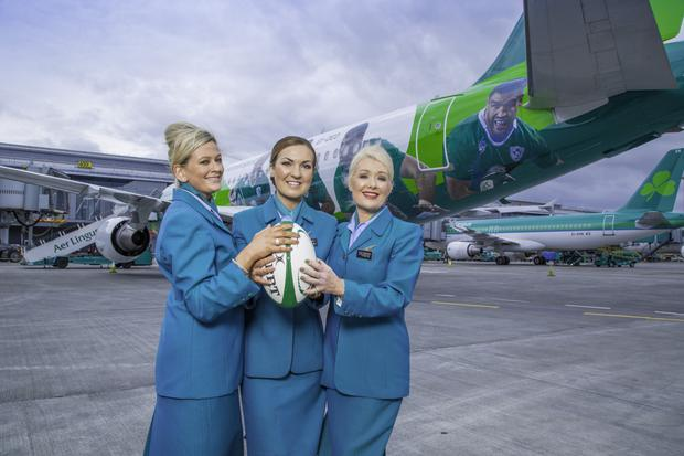 Cabin crew Sarah Nolan, Tracy Johansson and Gillian Kane with the Green Spirit, an Airbus 320, painted in IRFU livery