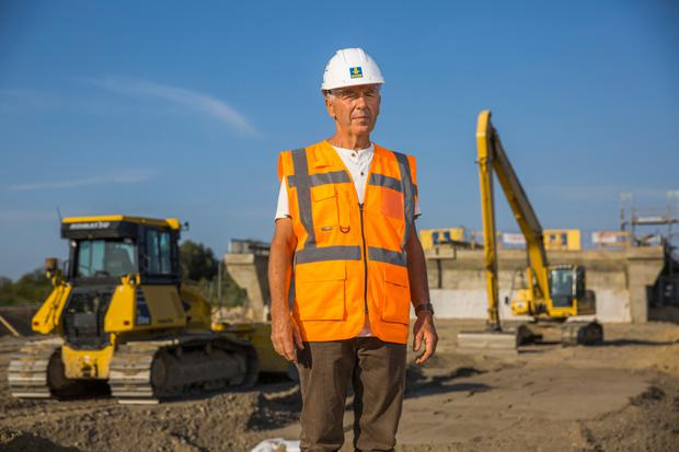 Hartmut Kolschewski, mayor of Lindholz, beside construction machinery during ongoing repair work on the A20 autobahn near Tribsees, Germany