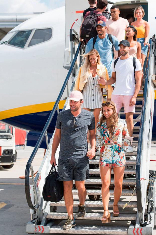 Love Island contestants arrive at Stansted Airport after the final of the show won by Dani Dyer and Jack Fincham. Photo: PA