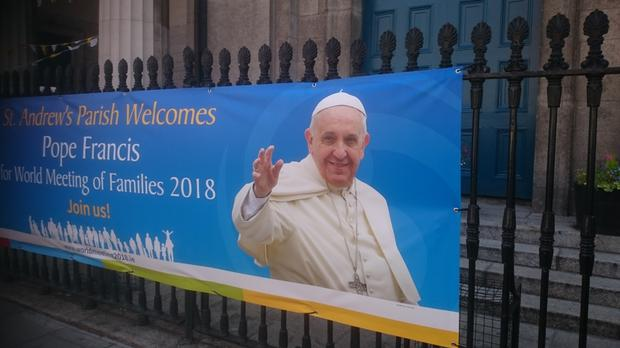 A banner outside St Andrew's in Westland Row, Dublin, welcomes Pope Francis to the WMoF
