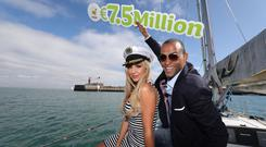 Former Mr and Miss World, Kamal Ibrahim and Rosanna Davison help promote the Lotto, which faces future disruption, on board a yacht in Dun Laoghaire