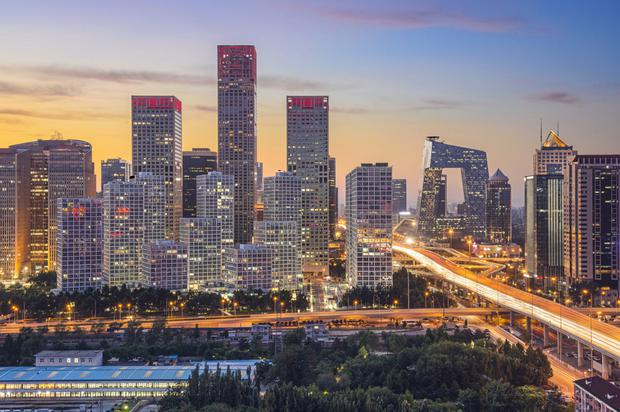 Pressure: China's developers are under pressure to refinance their debt, even as the housing boom in Beijing and other cities buoys earnings and pushes up margins