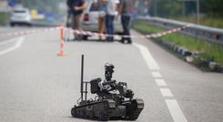On track: Bomb disposal is among the hazardous tasks which are set to be taken over by robots. Stock image