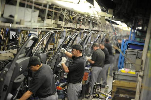 Rising gloom: Technicians prepare doors for Qashqai cars at Nissan's plant in Sunderland in England