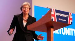 Not for turning: Theresa May, UK prime minister, gestures as she delivers her keynote speech during the recent Conservative Party annual conference where she extolled the virtues of Brexit. Photo: Bloomberg