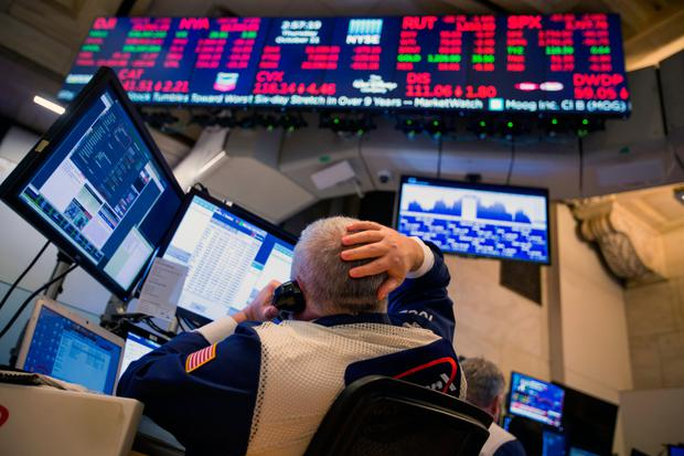 A trader works on the floor of the New York Stock Exchange as shares take a battering last week