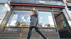 A woman walks past a branch of Patisserie Valerie in London. Photo: Reuters