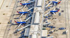 Buckle up: Airlines could see yields come under pressure due to continuing trade wars and slowing global economic growth. Stock image