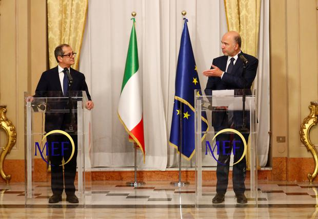 Italy's Economy Minister Giovanni Tria holds a news conference with European Economic Commissioner Pierre Moscovici at the Treasury ministry in Rome last week. Photo: Reuters