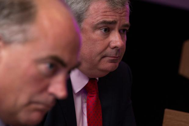 Bailing out: Bernard Byrne with CFO Mark Bourke who has also announced his departure from the lender