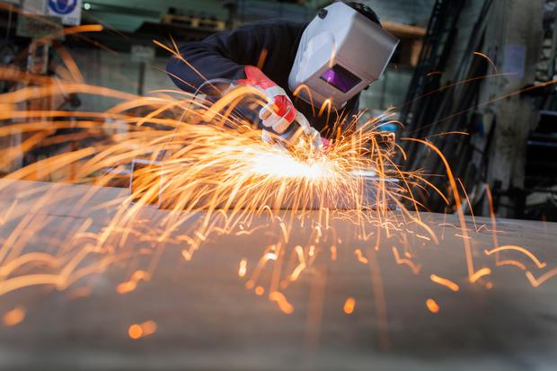 Manufacturing output increased at the slowest pace in seven months in October Stock image