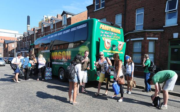 Tour leader: The firm's fleet of green coaches takes tourists on sightseeing trips across the country