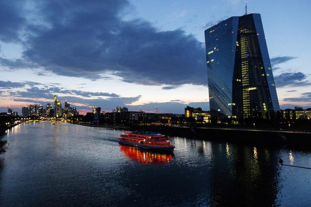 Challenge: The ECB in Frankfurt faces a dilemma as it cuts its bond-buying programme