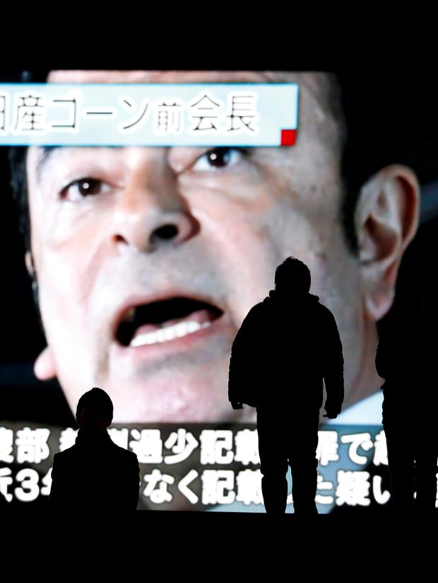 Big news: A street monitor in Tokyo broadcasts news reporting the indictment and re-arrest of ousted Nissan chairman Carlos Ghosn. Photo: Reuters
