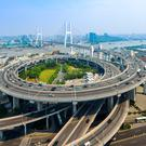 In traffic: Cars on a motorway in Shanghai – since July China has slapped a 40pc tariff on American-made cars