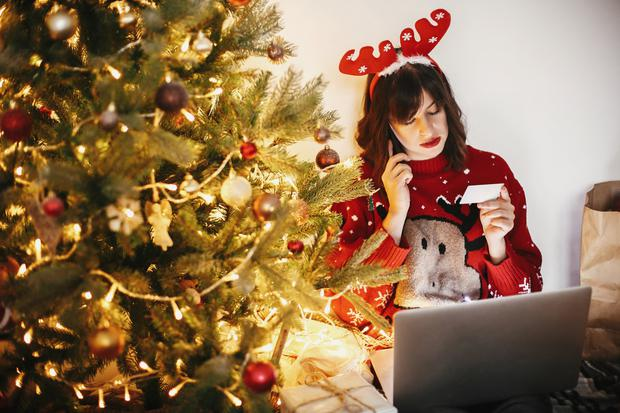 Christmas card: Our festive shopping spend has been called 'an orgy of wealth destruction'