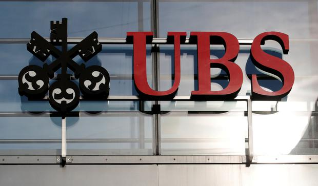 Bank: UBS paid some $300m in 2014 to settle claims it helped wealthy Germans dodge taxes. Photo: Reuters