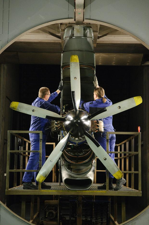 Technicians prepare an H80 turboprop engine for testing during manufacture at the GE Aviation plant, a unit of General Electric Co., in Prague, Czech Republic
