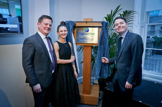 New offices: Finance Minister Paschal Donohoe with Lindsey McMurray of Pollen Street Capital and Ronan Horgan of Capitalflow. Photo: Maxwells