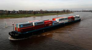 Above water: A barge on the Rhine – Germany has managed to offset weak demand in the eurozone