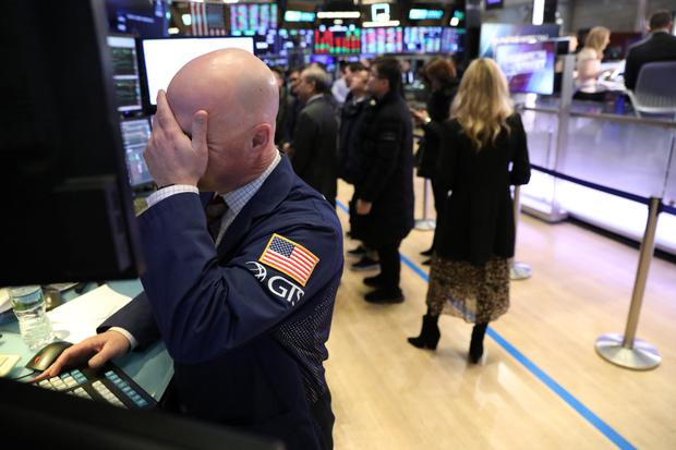 Unease: Traders work on the floor of the New York Stock Exchange this week at a time when uncertainty over trade talks is clouding the markets. Photo: Reuters