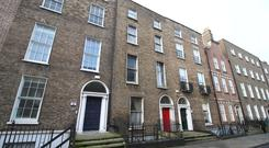 Room to improve: While 21 Lower Leeson St (middle) sold for €1.065m, its potential is reflected by 22 Lower Leeson St (left) which is for sale with a €1.8m guide price