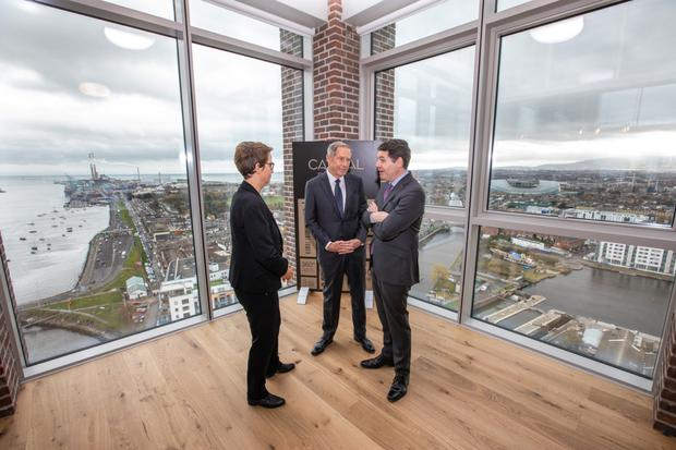 High hopes: Kennedy Wilson president Mary Ricks, chairman and CEO William J McMorrow and Finance Minister Paschal Donohoe at the firm's Capital Dock Campus