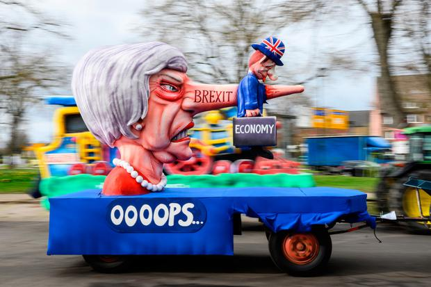 Full speed ahead: A float featuring an effigy of British Prime Minister Theresa May is seen prior to the annual Rose Monday Carnival parade in Dusseldorf, Germany. Photo: Getty