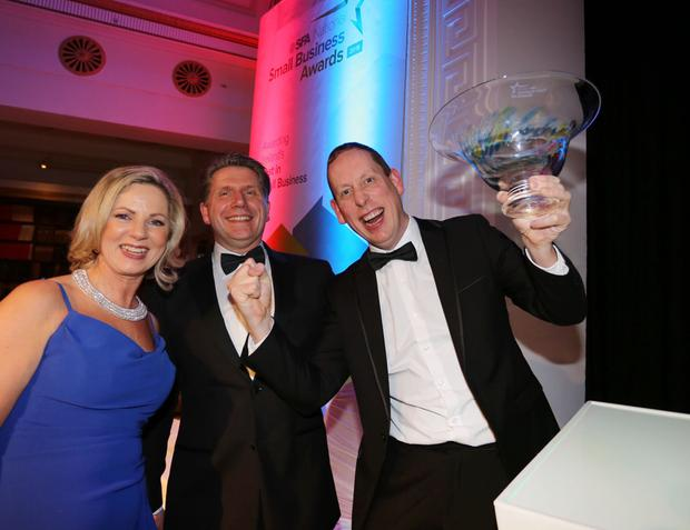 Overall winner David Gillen from Blueacre Technology (right) with Sue O'Neill, SFA Chair, and Sven Spollen-Behrens, director, SFA, at the National Small Business Awards 2019 at the RDS