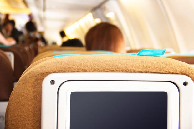 Entertainment: High-tech systems like this are used to provide passengers with a range of film and music options while airborne. Stock image