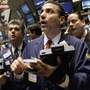 Traders react to market events on the floor of the New York Stock Exchange