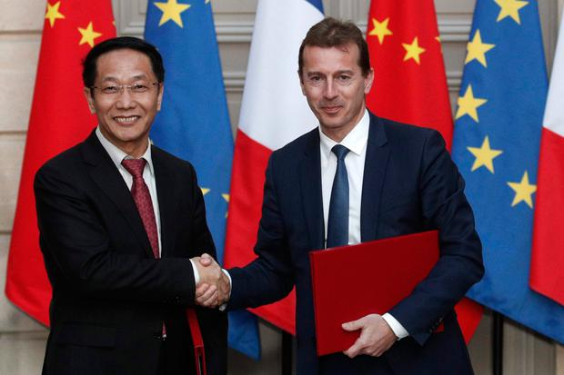 Jet sale: Airbus's president of commercial aircraft business Guillaume Faury and China Aviation Supplies chairman Jia Baojun shake hands on a deal for 300 jets at the Elysee Palace in Paris