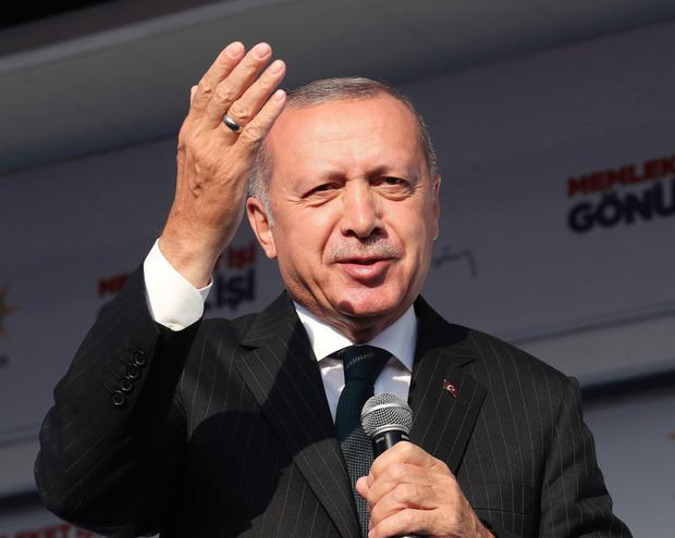 Turkey President Recep Tayyip Erdogan has threatened to punish bankers who speculated against the currency. Photo: AP