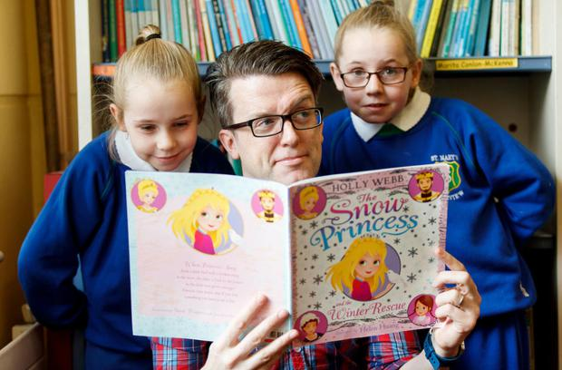 Tony Cummins, an ESB volunteer on Business in the Community Ireland's 'Time to Read' literacy volunteering programme, partnered with Amber and Rhianna Skerritt from St. Mary's school in Fairview, Co Dublin.