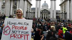 Public anger: a sit-down protest in a 'Raise the Roof' rally outside Government Buildings in Dublin last October. Photo by Reuters