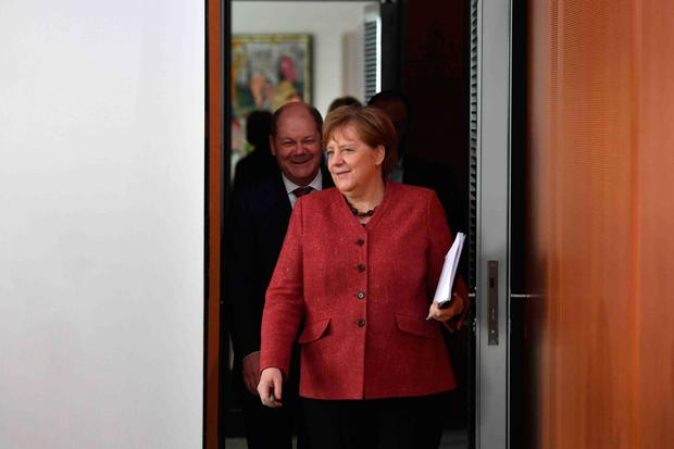 German Finance Minister Olaf Scholz with Chancellor Angela Merkel. Photo: AFP/Getty Images