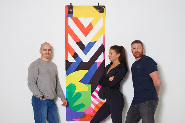 John Belton, Adrienne Murphy, and Maser with the FlowState mat