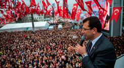 Tensions: Republican People's Party (CHP) mayoral candidate, Ekrem Imamoglu, waves to the crowd during a rally in Istanbul. Photo: AFP/Getty Images